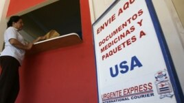 A woman makes a transaction at a remittance office in Nacaome, Honduras.