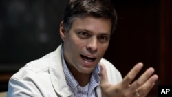 FILE - In this Feb. 26, 2013 file photo, opposition leader Leopoldo Lopez gives a press conference in Caracas, Venezuela.