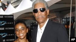 "FILE - Actor Morgan Freeman and his step-granddaughter E'Dena Hines attend the world premiere of ""The Dark Knight"" at AMC Loews Lincoln Square in New York, July 14, 2008."