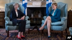 Britain's new Prime Minister Theresa May, left, meets with First Minister of Scotland, Nicola Sturgeon at Bute House in Edinburgh, Scotland, last July, after the Brexit vote. (Pool via AP)