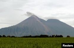 The Fuego volcano is seen from San Miguel Los Lotes in Escuintla, Guatemala, June 7, 2018.