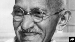 Indian leader Mohandas K. Gandhi, also known as Mahatma Gandhi, smiles in this 1947 file photo, location unknown.