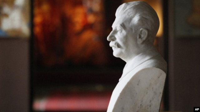 A bust of Soviet dictator Josef Stalin sits inside a museum dedicated to him in the town of Gori, some 80 kilometers west of the Georgian capital Tbilisi,  April 9, 2012.