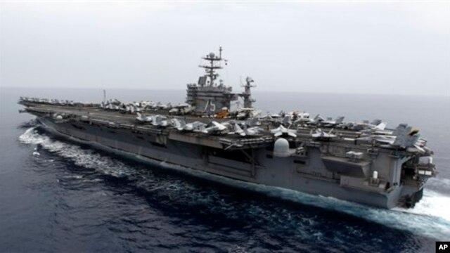 Kapal Induk Amerika USS Harry S.Truman (Foto: dok). Pentagon menangguhkan keberangkatan dua kapal perang ke Teluk Persia, USS Harry S.Truman dan USS Gettysburg karena kemungkinan pemotongan anggaran.