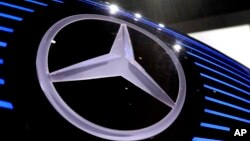FILE- The logo of Mercedes is photographed at the annual news conference at the company's headquarters in Stuttgart, Germany.