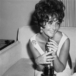 "Elizabeth Taylor holds the Academy Award she won for her role in ""Butterfield 8"""