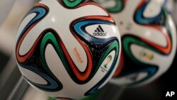 "The adidas logo is printed on ""Brazuca"", the official FIFA World Cup 2014 soccer ball, during the annual shareholders meeting in Fuerth, Germany, May 8, 2014."