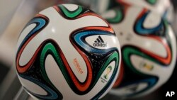 "The adidas logo is printed on ""Brazuca"", the official FIFA World Cup 2014 soccer ball."