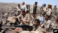 A handout photo from Yemen's Defense Ministry shows Yemeni troops taking position during the fight against al-Qaida militants in the southern province of Shabwa, April 30, 2014.