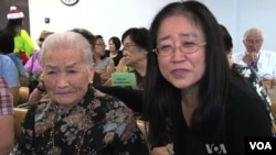 Ching Fen Wang, 95, and her daughter at a Senior Center talent show in Los Angeles.