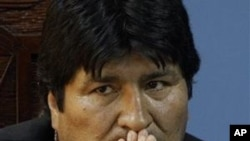 Bolivia's President Evo Morales gestures during a meeting, 10 Oct 2010