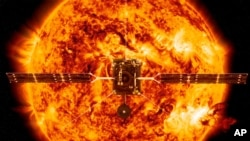This illustration made available by NASA depicts the Solar Orbiter satellite in front of the Sun. European Space Agency have planned to launch the spacecraft on a mission to the sun to get close-up views of its polar regions. (ESA/ATG medialab, NASA/SDO/