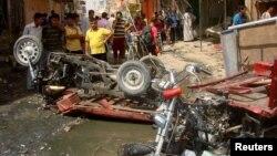 Hiện trường sau vụ đánh bom tại một ngôi chợ ở Diwaniya, 95 dặm về phía nam thủ đô Baghdad, ngày 3/7/2012