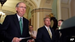FILE - Senators Mitch McConnell (L) and Lindsey Graham approach a podium to speak to the media on Capitol Hill in Washington.