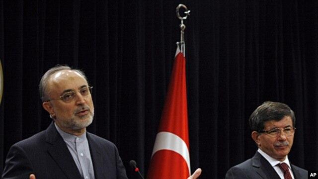 Turkish Foreign Minister Ahmet Davutoglu, right, and his Iranian counterpart Ali Akbar Salehi speak to the media after talks in Ankara, Turkey, October 21, 2011.