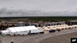 FILE - This undated photo provided by the Administration for Children and Families, a division of the Department of Health and Human Services, shows the shelter used to house unaccompanied migrant children in Tornillo, Texas.
