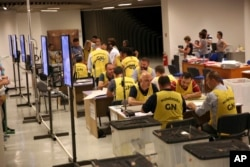 Election staff count ballots in Tirana, Albania, June 26, 2017. Albania's left-wing Socialist Party appears headed for a new governing mandate.