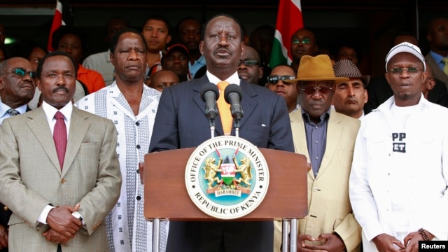 Kenya's Prime Minister Raila Odinga (C), flanked by members of the Coalition for Reforms and Democracy (CORD), addresses the media outside his office in Nairobi, March 16, 2013.
