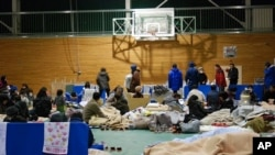 Japanese evacuees at Koriyama High School gymnasium, Koriyama, Fukushima Prefecture, Japan, March 16, 2011.