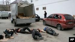 Bodies of four killed suspected militants are seen in Derbent region of Dagestan, April 18, 2011.