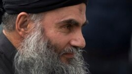 FILE - Abu Qatada arrives back at his residence in London after being freed from prison, Nov. 13, 2012.