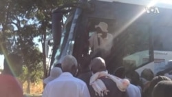 No Social DIstancing, Few Masks As Zimbabweans Jostle for Bus Ride