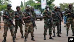 FILE - Ghana's military and police maintained order during the 2012 elections. Hikes in civil service wages during that election caused the deficit to soar.