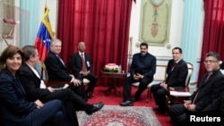 Venezuela's President Nicolas Maduro (center R) speaks to the Union of South American Nations' (UNASUR) foreign ministers at the Miraflores Palace in Caracas in this handout picture provided by the Miraflores Palace, April 7, 2014.