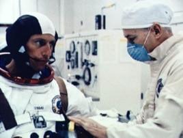 Astronaut Joseph Kerwin suits up.