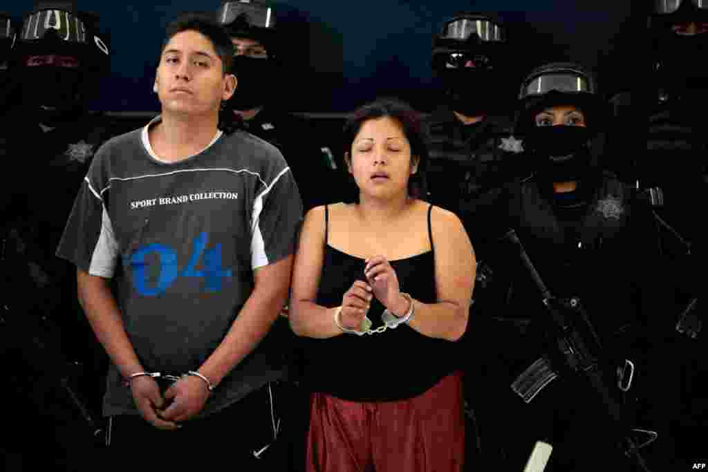 """June 15: Members of the criminal kidnapping organization """"Los Providencia"""" after their arrest on the outskirts of Mexico City June 16, 2011. (REUTERS/Jorge Dan Lopez)"""