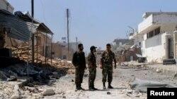 Anggota pasukan pemerintah Suriah pro-Assad berpatroli di wilayah Qusair, Suriah, 6 Juni 2013 (Foto: dok).