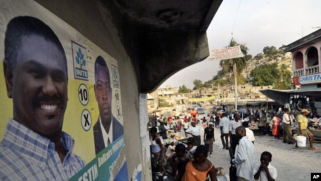 A poster of Haiti's presidential candidate Jude Celestin is seen in a street market in Port-au-Prince. A leaked report on Haiti's disputed November 28 elections by Organization of American States experts recommends that a government-backed presidential ca