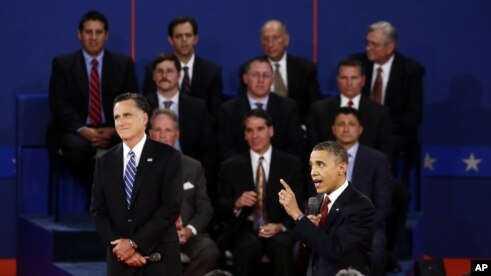 President Barack Obama speaks as Republican presidential candidate Mitt Romney listens during the second presidential debate at Hofstra University, Hempstead, New York, October 16, 2012.