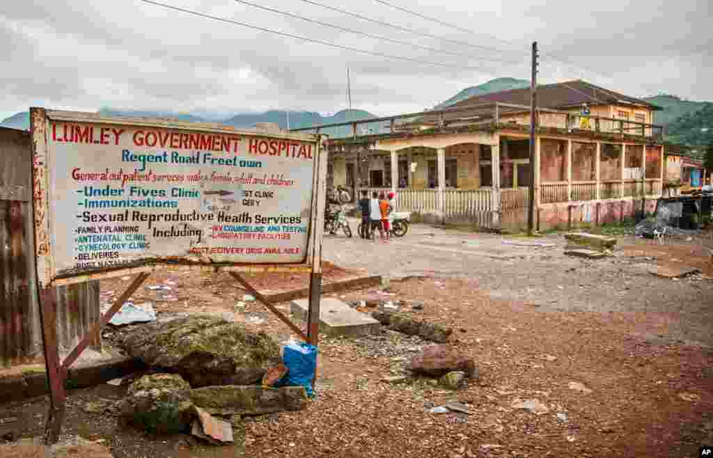 A sign showing directions to the Lumley Government Hospital, where medical doctor Olivet Buck worked before contracting the Ebola virus and passing away on Saturday, near Freetown, Sierra Leone, Sept. 15, 2014.