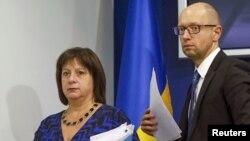 Ukraine's Prime Minister Arseny Yatseniuk and Finance Minister Natalia Yaresko leave a news conference in Kyiv, Ukraine, Oct. 15, 2015.