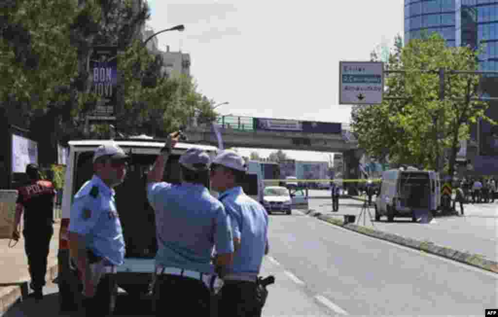 Security members and forensic experts work at the scene after a bomb exploded at a bus stop during rush hour in Istanbul, Turkey, Thursday, May 26, 2011. Seven people were injured as several ambulances rushed to the scene on a multi-lane thoroughfare in a