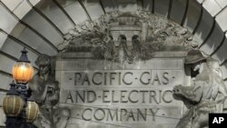 FILE - A Pacific Gas & Electric sign is shown outside a PG&E building in San Francisco, Oct. 10, 2019.