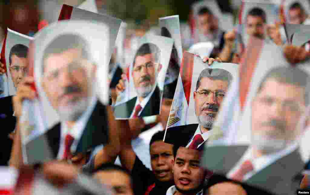 Supporters of Morsi during a demonstration outside the Egyptian embassy in Kuala Lumpur, Malaysia, July 26, 2013.