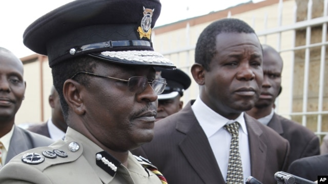 Kenyan Commissioner of Police Mathew Kirai Iteere, left, addresses media on the weekend attack on the police officers in Samburu, northwestern Kenya at Wilson Airport Nairobi, Kenya, Tuesday, Nov. 13, 2012.