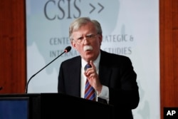 FILE - Former National Security Adviser John Bolton gestures while speaking at the Center for Strategic and International Studies in Washington, Sept. 30, 2019.