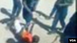 Police are seen in the video beating up the Zimbabwean with tree whips while laughing at the victim. (Photo of the video)