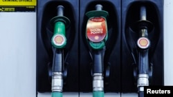 FILE - Fuel pumps are seen at a Shell petrol station in London.