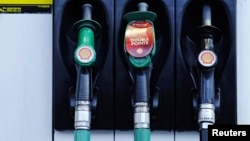 Fuel pumps are seen at a Shell petrol station in London, Jan. 31, 2013.