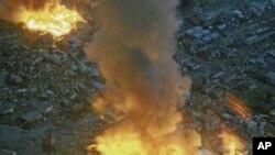日本大地震发生后,岩手地区的建筑物在燃烧