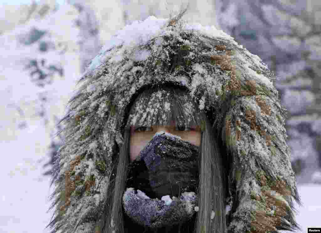A woman takes a selfie in a snowy wood on the bank of the Yenisei river, with the air temperature at about minus 21° C (- 5.8° F), outside the Siberian city of Krasnoyarsk, Russia.