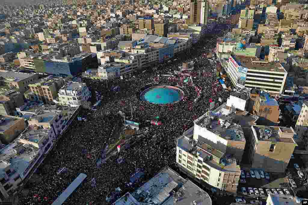 In this aerial photo released by an official website of the office of the Iranian supreme leader, mourners attend a funeral ceremony in Tehran for Gen. Qassem Soleimani and his comrades, who were killed in Iraq in a U.S. drone strike.