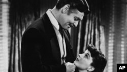 "Clark Gable, as Rhett Butler and Vivien Leigh as Scarlett O'Hara stars in the 1939 classic, ""Gone With the Wind""."