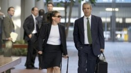 Samsung lawyers Kevin Johnson and Victoria Maroulis leave court last month after a jury in San Jose, California, ordered the company to pay Apple $1 billion for patent violations