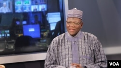 Jigawa State Governor Sule Lamido (R) waits on set for interview to begin.