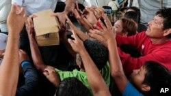 A person distributes food to hurricane victims under a bridge in San Pedro Sula, Honduras. (File)